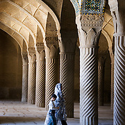 Woman and child entering the Regent´s mosque. Shiraz, Iran.