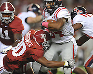 Ole Miss running back Brandon Bolden (34) is tackled by Alabama linebacker Dont'a Hightower (30) at Bryant-Denny Stadium in Tuscaloosa, Ala.  on Saturday, October 16, 2010. Alabama won 23-10.