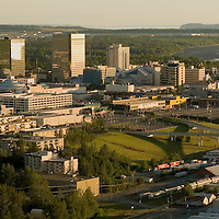 Anchorage's office buldings and hotels shine in the early evening light in this southwest bird's-eye view of downtowns's central core.