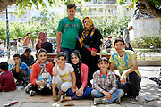 Abbashi family from Herat, Afghanistan at Victoria square while they are waiting to find a way to travel to a northern european country, preferably Germany. 5 years ago the husband and the wife (standing) got injured in a suicide bombing. The husband spent 2 years in bed until he could recover and since then they tried to save money to bring the family out of the country. They now have no money and are waiting for some help to be able to continue their trip.<br /> Victoria square in Athens is one of the main gathering places for refugees. They stay there until they can find a way to travel to Thessaloniki and to the northern border of Greece where they can cross on foot on their way to northern European countries.