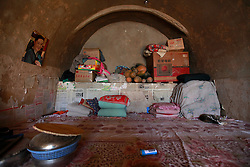 A picture made available on 06 November 2012 of a view of the interior of Chinese corn farmer Yang Zhichong's cave home or 'yaodong', where cracks are abundant on the walls, in the rural outskirts of Yan'an city, Shaanxi Province China, 05 November 2012. Yang's family of five struggle to survive on their yearly income of 10,000 RMB (1,248 euros) from growing and selling corn. Their cave home is in danger of collapsing but there was no money to carry out repair work. The 'yadong' or cave dwellings are typical in the plateaus of northern China in Shaanxi Province where many of Yan'an's rural population still live in. They are mostly carved out from the yellow earth of the Loess hillsides and are about seven to eight metres deep with height and width of three metres. Former Communist leader Mao Zedong and his comrades are known to have hid in these cave homes during the civil war between the communists and nationalists in 1936 to 1948 as they battle the Kuomintang forces. Chao has lived in his cave home in the Loess mountains of Yan'an for more than 60 years, mostly in poverty and hardship as a farmer and was one of the few to have lived through the period of turmoil during the civil war. China's new leaders slated to take over during the 18th National Congress beginning on 08 November are likely to face mounting pressures to tackle the country's rising income inequalities between urban and rural areas that are often the source of simmering resentment and growing unrests on the grassroot level.