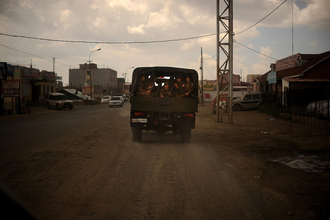 A truck full of Mongolian Soldiers drive down the street in Ulaanbaatar, Mongolia. — © Jeremy Lock/USAF