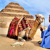 Camel and Egyptian Man at Step Pyramid Cairo, Egypt<br />