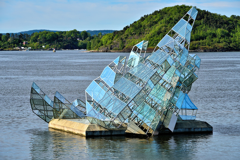 Glass Iceberg Sculpture in Oslo, Norway<br /> At first glance, this glass and steel sculpture resembles a sailboat but, according to artist Monica Bonvicini, &ldquo;She Lies&rdquo; is meant to represent an iceberg.  Hun ligger floats and turns in front of the Oslo Opera House. This artwork was made possible by a donation from Christen Sveaas and unveiled in 2010. It quickly has become an Oslo landmark.