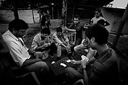 playing cards while waiting for their wives to come from the religious ceremony.<br /> <br /> The gipsies call it &quot;the Cult&quot;, it is a kind of pact that they get together twice a week in a common hut to pray for good and exorcise the evil. Inside the hut there&acute;s a heavy atmosphere and things seem to be a blend of fantasy and reality. Tens of gipsies form a circle of screams and cries and you can hear a mix of prays, complains, desperation and guilt. A gipsie women faints on the floor almost like she has been exorcised and she had a demon inside her, slowly with the help of the others she recovers.<br /> The truth is that the cult is a way that gipsies chose to express themselves, something that is very much theirs, just like the sound of the gipsies guitars, shows something very real, the suffering of their spirits.