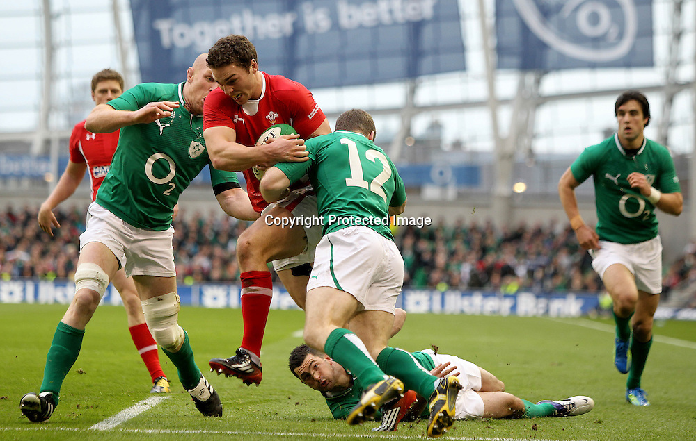RBS Six Nations Championship, Aviva Stadium, Dublin 5/2/2012<br /> Ireland vs Wales<br /> Ireland's Paul O'Connell and Gordon D'Arcy tackle George North of Wales<br /> Mandatory Credit &copy;INPHO/James Crombie