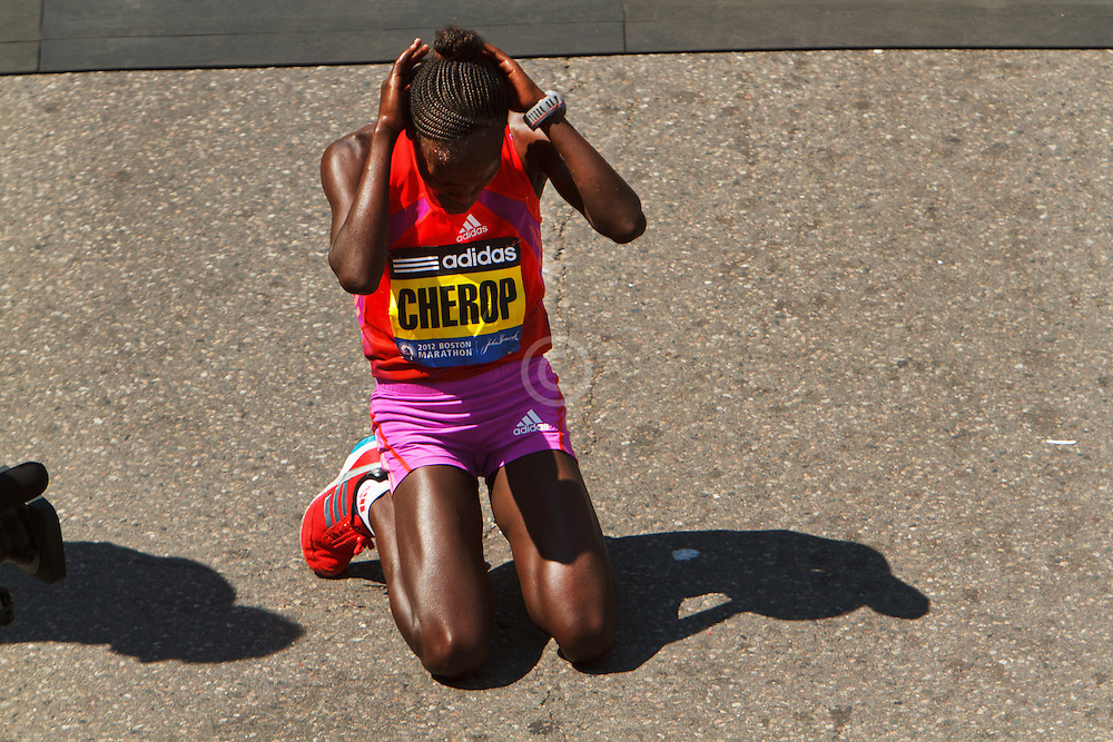 Sharon Cherop falls to knees after winning Boston Marathon