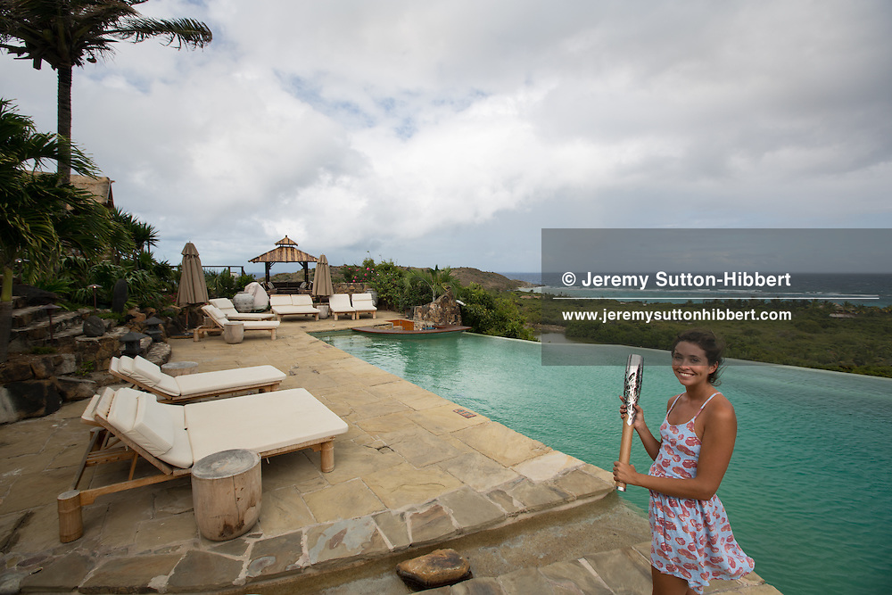 The Queen's Baton carried by Alexandra (Ali) Crook, on Richard Branson's Necker Island, in the British Virgin Islands, Friday 4 April 2014. British Virgin Islands is nation 53 of 70 nations and territories the Queen's Baton will visit.