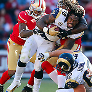St. Louis Rams running back Steven Jackson (39) runs without his helmet while being tackled by San Francisco 49ers inside linebacker Patrick Willis (52) during the NFL regular season game on Sunday, Nov. 11, 2012 in San Francisco, Calif.