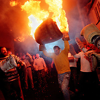 """RAISING THE  FLAMING BARREL"".TAR BARRELS OF OTTERY ST MARY EAST DEVON..BY RUPERT RIVETT©2003..07771928201.(01273)695107"