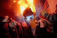 """RAISING THE  FLAMING BARREL"".TAR BARRELS OF OTTERY ST MARY EAST DEVON..BY RUPERT RIVETT©2003..07771928201.(01273)695107"