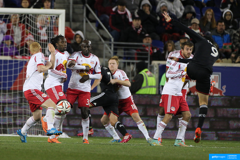 The New York Red Bulls wall blocks a free kick taken by Fabian Espindola, DC United, during the New York Red Bulls V DC United, MLS Cup Playoffs, Eastern Conference Semifinals first leg at Red Bull Arena, Harrison, New Jersey. USA. 2nd November 2014. Photo Tim Clayton