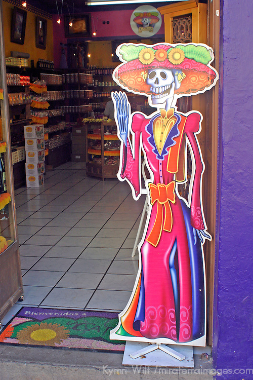 Americas, Mexico, Guanajuato. La Catrina, a skeletal woman symoblizing death, greets visitors to the sweet shop of the same name in Guanajuato.