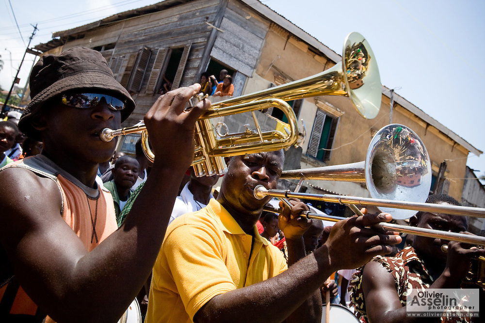 Men play brass instruments during the  the parade held on the occasion of the annual Oguaa Fetu Afahye Festival in Cape Coast, Ghana on Saturday September 6, 2008.