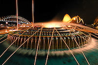 Sydney Harbor is vibrant not only durinig the day, but also at night, seen here with a fountain in the foreground, and the Harbour Bridge and Opera House in the background.