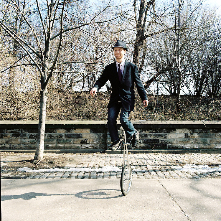 Unicyclist in Prospect Park Brooklyn.