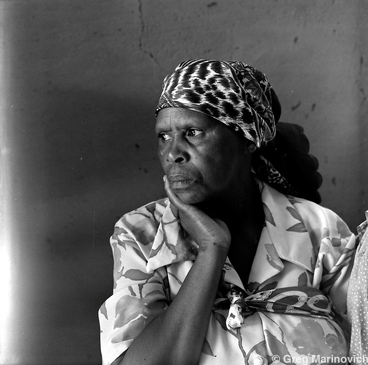 A mourner at the funeral of a young man, Qwaggafontein farm, Ficksburg district, free State, March 2002. Greg Marinovich