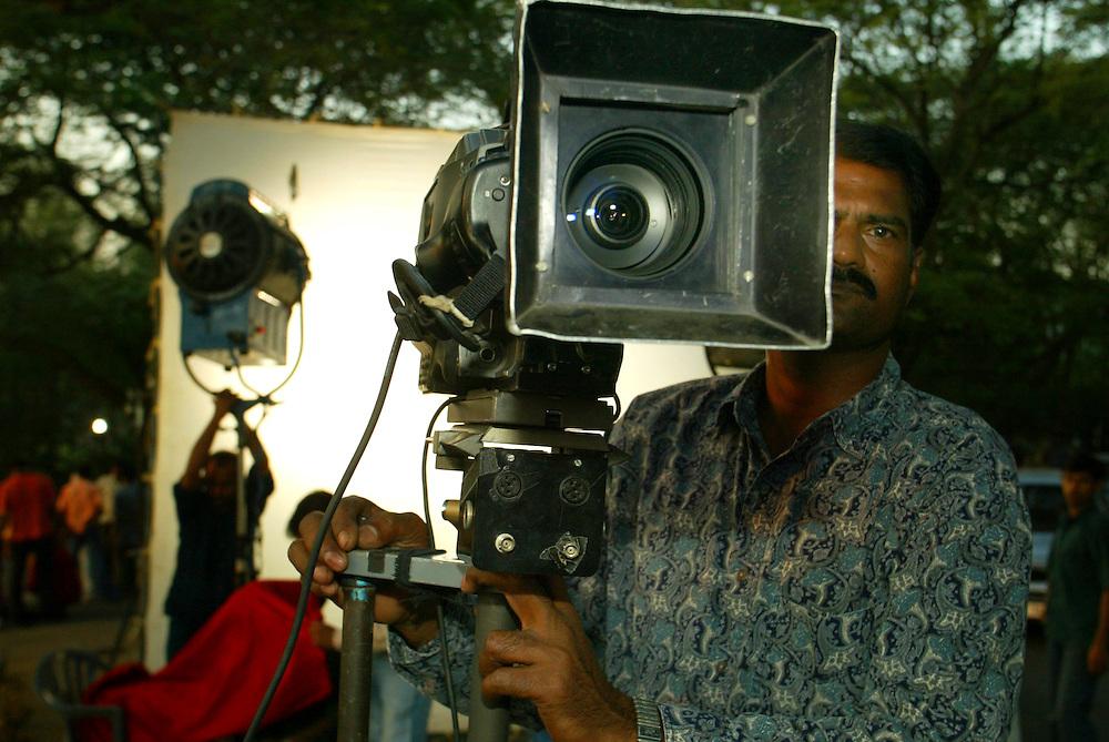 A camera man works on a film set in Mumbai, Tuesday Dec. 7, 2004.