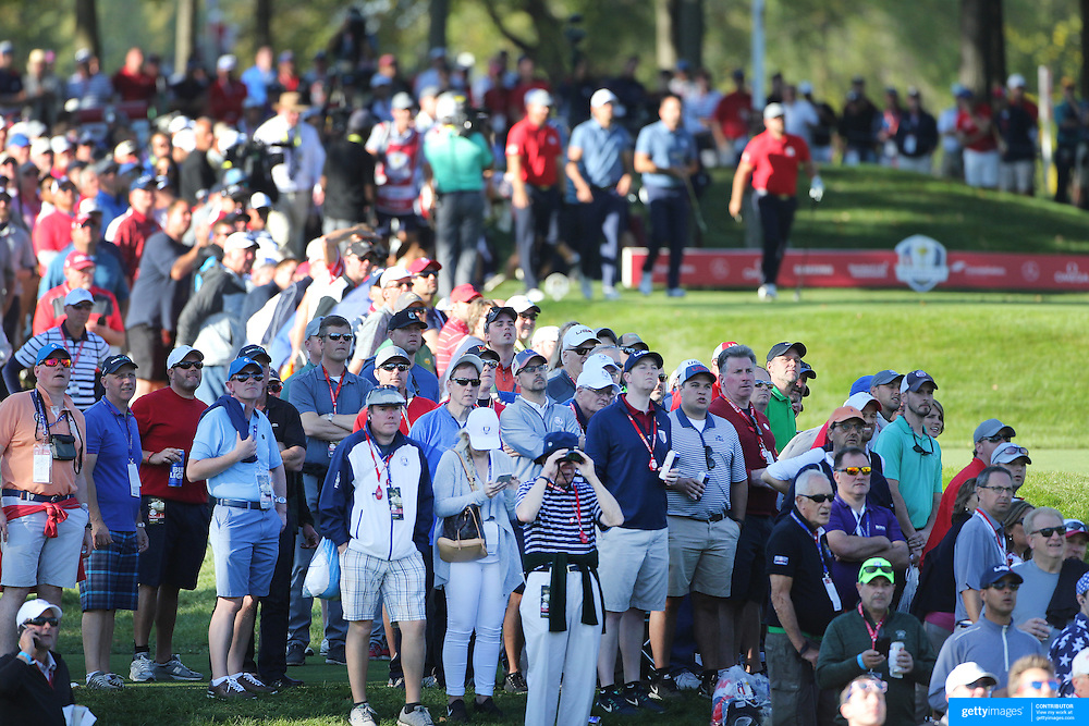 Ryder Cup 2016. Day One. Spectators watching the tee shot of Ryan Moore of the United States in action during the Friday afternoon four-ball competition during the Ryder Cup at  Hazeltine National Golf Club on September 30, 2016 in Chaska, Minnesota.  (Photo by Tim Clayton/Corbis via Getty Images)
