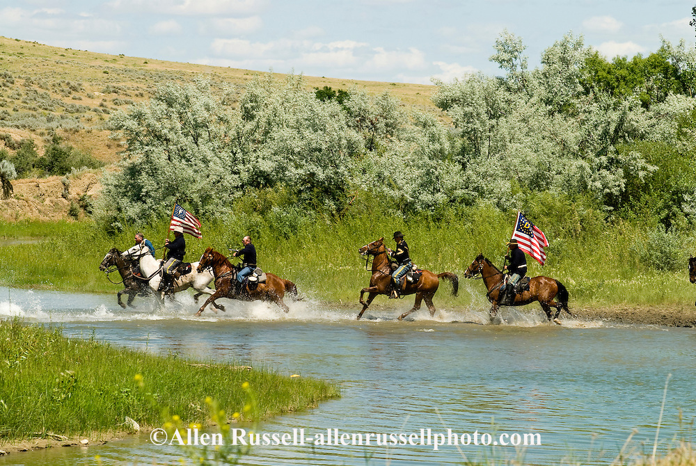 Custers Last Stand Reenactment, Crow Indian Reservation on Little Bighorn River, Montana, 7th Cavalry soldiers cross Little Bighorn to attack Indian Camp.