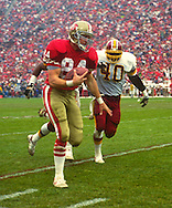 SAN FRANCISCO:  Brent Jones of the San Francisco 49'ers runs with the football during an NFL game against the Washington Redskins at Candlestick Park in San Francisco, California.  (Photo by Ron Vesely)