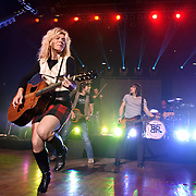 """COLUMBIA, MD - October 16th, 2011: Kimberly Perry and her brothers Neil Perry and Reid Perry of The Band Perry perform at the 2011 Sunday In The Country festival at Merriweather Post Pavilion in Columbia, MD. The band's single """"If I Die Young"""" reached number one on the Billboard Hot Country Songs chart.  (Photo by Kyle Gustafson/For The Washington Post)"""