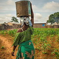 The small Ghanian village of Tichirigitaba has no well, so women must carry water for drinking, cooking and washing from distance sources.
