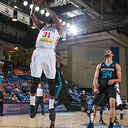 Delaware 87ers Forward ROSCOE SMITH (31) drives towards the basket as Greensboro Swarm Forward Perry Ellis (34) looks on in the first half of an NBA D-league regular season game between the Delaware 87ers and the Greensboro Swarm (Charlotte Hornets) Wednesday, March 29, 2017, at The Bob Carpenter Sports Convocation Center in Newark, DEL