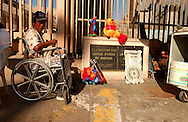 A man in wheelchair pauses near the US / Mexico border in Tijuana, Mexico on Tuesday, July 27, 2004. Tijuana, Mexico borders the US town of San Ysidro, CA.