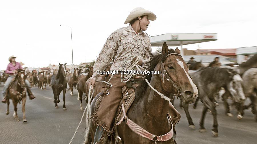 cowboys and horses on the streets of browning montana, tal michael memorial