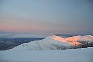 Sunlight on distance peaks as seen from Mount Washington.