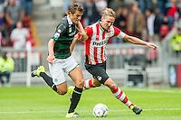 EINDHOVEN - PSV - FC Groningen , Voetbal , Seizoen 2015/2016 , Eredivisie , Philips stadion , 16-08-2015 , FC Groningen speler Etienne Reijnen (l) in duel met PSV speler Luuk de Jong (r)