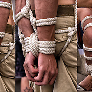 S&amp;M Bondage, close up of slave being tied up with ropes at Folsom Street East, S&amp;M-leather-fetish themed street festival.<br />