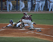Ole Miss' Tanner Mathis (12) is tagged out at home by Mississippi State catcher Wes Thigpen (31) at Oxford-University Stadium in Oxford, Miss. on Thursday, May 12, 2011. (AP Photo/Oxford Eagle, Bruce Newman)
