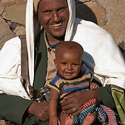 Child with parents at Simien Mountains N.P., Ethiopia
