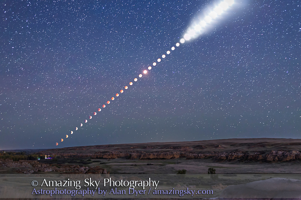 This is a multiple-exposure composite of the total lunar eclipse of Sunday, September 27, 2015, as shot from Writing-on-Stone Provincial Park, Alberta, Canada. <br /> <br /> From this location the Moon rose in the east at lower left already in partial eclipse. As it rose it moved into Earth&rsquo;s shadow and became more red and the sky darkened from twilight to night, bringing out the stars. Then, as the Moon continued to rise higher it emerged from the shadow, at upper right, and returned to being a brilliant Moon again, here overexposed and now illuminating the landscape with moonlight.<br /> <br /> The disks of the Moon become overexposed here as the sky darkened because I was setting exposures to show the sky and landscape well, not just the Moon itself. That&rsquo;s because I shot the frames used to assemble this multiple-exposure still image primarily for use as a time-lapse movie where I wanted the entire scene well exposed in each frame. <br /> <br /> Indeed, for this still image composite of the eclipse from beginning to end, I selected just 40 frames taken at 5-minute intervals, out of 530 I shot in total, taken at 15- to 30-second intervals for the full time-lapse sequence. <br /> <br /> All were taken with a fixed camera, a Canon 6D, with a 35mm lens, to nicely frame the entire path of the Moon, from moonrise at left, until it left the frame at top right, as the partial eclipse was ending.<br /> <br /> The ground comes from a blend of 3 frames taken at the beginning, middle and end of the sequence, so is partly lit by twilight, moonlight and starlight. Lights at lower left are from the Park&rsquo;s campground.<br /> <br /> The sky comes from a blend of 2 exposures: one from the middle of the eclipse when the sky was darkest and one from the end of the eclipse when the sky was now deep blue. The stars come from the mid-eclipse frame, a 30-second exposure. <br /> <br /> PLEASE NOTE: The size of the Moon and its path across the sky are accurate here, becau