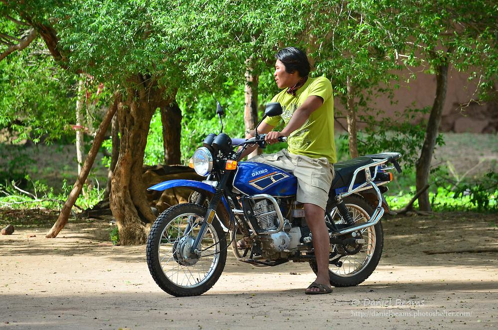 Guarani man on a motorcycle in Yapiroa, Izozog, Santa Cruz, Bolivia