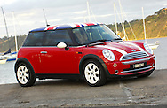 2005 MINI Cooper Chilli hatch in Chili Red/White.(C) Joel Strickland Photographics.Use information: This image is intended for Editorial use only (e.g. news or commentary, print or electronic). Any commercial or promotional use requires additional clearance.