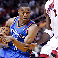 16 March 2011: Oklahoma City Thunder point guard Russell Westbrook (0) dribbles during the Oklahoma City Thunder 96-85 victory over the Miami Heat at the AmericanAirlines Arena, Miami, Florida, USA.