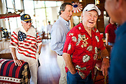 Barron Hilton, and Gen. Chuck Yeager, right, greet guests at Las Vegas developer Tony Marnell's vacation home in the Delta, July 4, 2010.