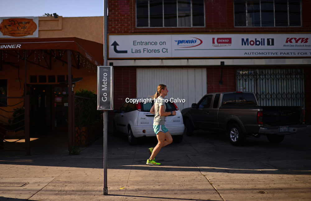 Young woman running in Venice, Los Angeles.