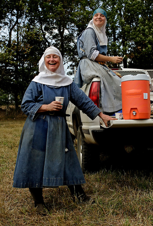 BETHLEHEM, CT- 11 OCTOBER 2005-Sisters Esther Agee (left) and Alma Egger of the Abbey of Regina Laudis take a break from a day of haying at one of the Abbey's 12 hay fields. <br /> (Photo by Robert Falcetti)