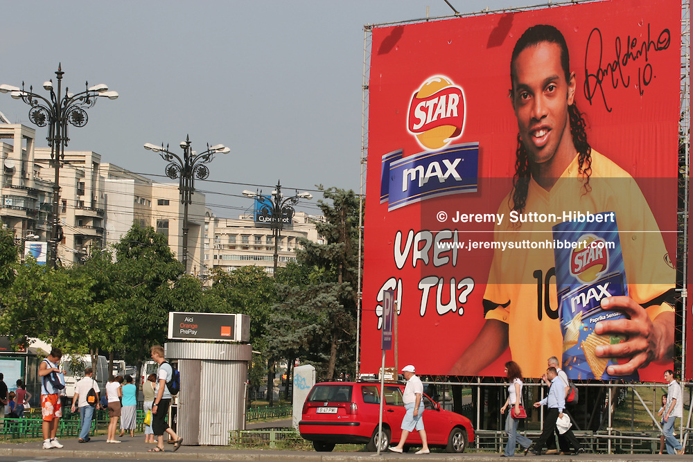 Street scene with advertising boards depicting Brazilian footballer Ronaldinho, in Piata Unirii, in the city of Bucharest, Romania, on Wednesday 2nd August 2006. On January 1st 2007, and only 17 years after the bloody revolution that overthrew Communist dictator Nicolae Ceaucescu, Romania, along with Bulgaria, will join the European Union. Certain conditions have been put in place that must be met by Romania, these being a review of the judicial and tax systems, and a clamp down on corruption.