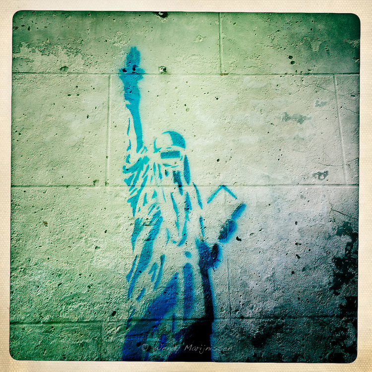 Graffiti of the statue of liberty in burqa in the city centre of Antwerp. Belgium, 2012