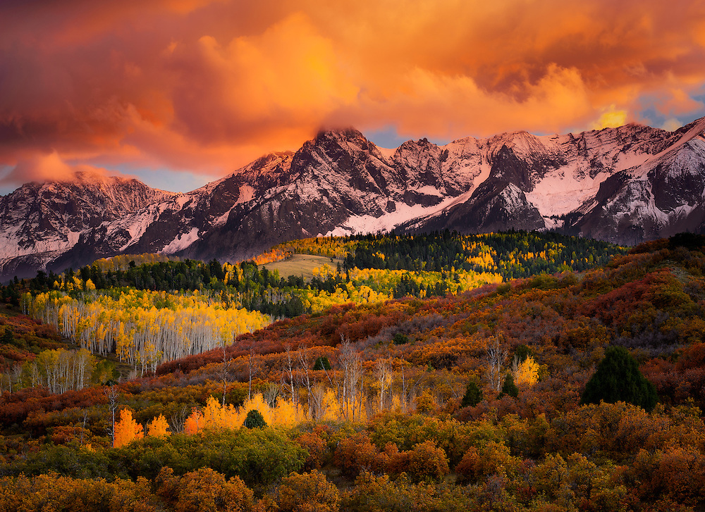 An eruption of color in the San Juan Mountains of Colorado as the aspens and scrub oaks transition to their autumn palette and the sky absorbs the last rays of the setting sun.
