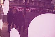 Street reflection of sudents at London Metropolitan University's Holloway Road.