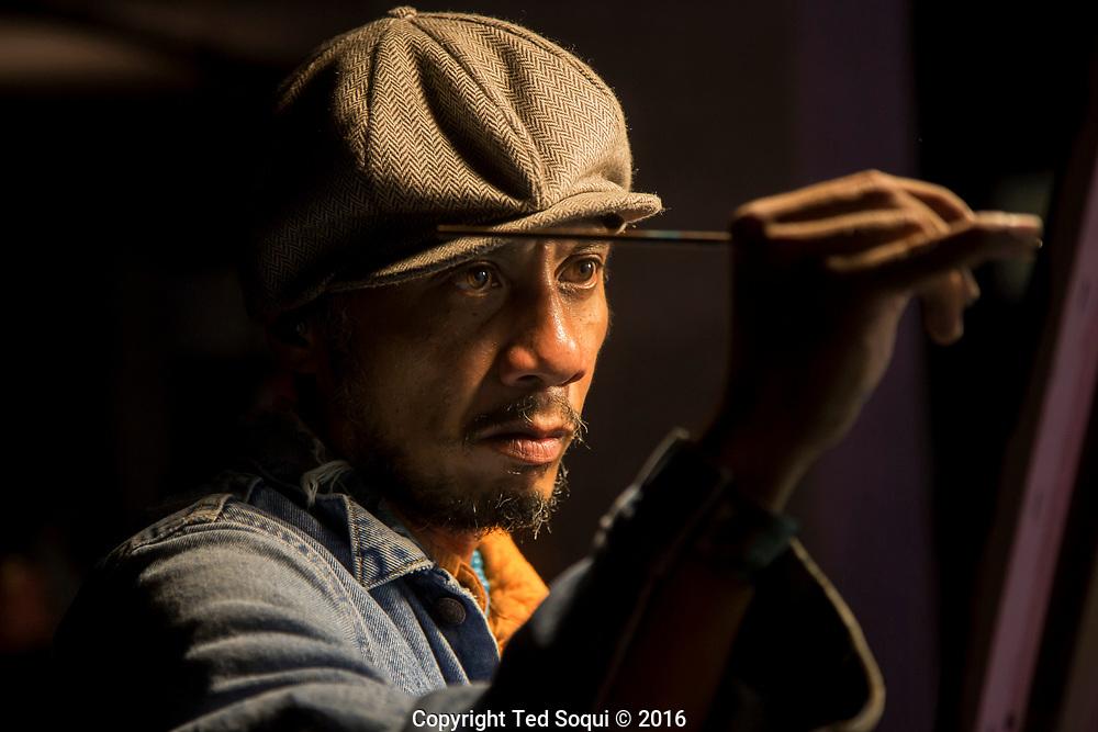 Portrait of artist Mitchelito Orquiola working in Playa Vista, CA.