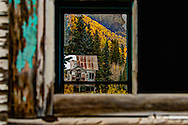 As We Peek Through The Window Of A Miners Cabin We See The Aspen And Pines Surrounding The Last Cabin, In The Red Mountain Mining District, That Lies Between Ouray And Silverton On Highway 550, Commonly Known As The Million Dollar Highway
