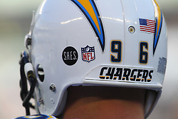 Dec 23, 2012; East Rutherford, NJ, USA; San Diego Chargers linebacker Jarret Johnson (96) helmet showing a sticker in memory of the Sandy Hook Elementary School shooting during the first half at MetLIfe Stadium.