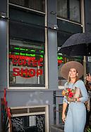 AMSTERDAM Queen M&aacute;xima at the redli light district  passes a coffeeshop attends Tuesday September 22 in Amsterdam at the opening of the renovated Ons' Lieve Heer op Solder. The museum has a new entrance building and the restoration and refurbishment of the 17th-century house has been completed with the secret attic church. COPYRIGHT ROBIN UTRECHT<br /> <br /> AMSTERDAM - Koningin M&aacute;xima loopt langs een coffeeshop op de wallen woont dinsdagmiddag 22 september in Amsterdam de opening bij van het vernieuwde Museum Ons&rsquo; Lieve Heer op Solder. Het museum heeft een nieuw entreegebouw en de restauratie en herinrichting van het 17e-eeuwse huis met de verborgen zolderkerk is afgerond. COPYRIGHT ROBIN UTRECHT